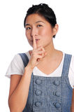 Silence please. Girl asks someone to be quiet Royalty Free Stock Images