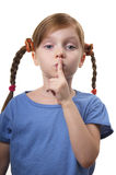 Silence please!. Little girl gesturing silence sign isolated over white background Stock Photography