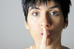 Silence please. A brunette woman asking for silence Royalty Free Stock Photography