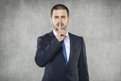 Silence Please, Businessman Doing Silence Sign Royalty Free Stock Image