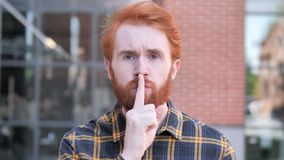Silence Please, Finger on Lips by Redhead Beard Young Man stock video footage