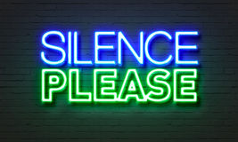 Silence please neon sign on brick wall background. Stock Photography