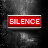Silence please. Silence warning board message is lit on a light message display Stock Image