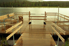 Silence of rain over pontoon. Rain over lake with wooden pontoon Royalty Free Stock Images