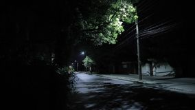 Road with low traffic. Crickets singing at night, contains original audio. Silence. Road with low traffic. Crickets singing at night, contains original audio stock footage