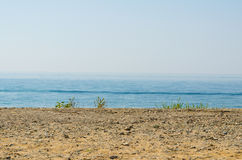 Silence seashore. Blue haze horizon view. Water blur background Stock Photos