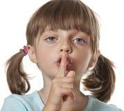 Silence or secret concept. Portrait of little girl Stock Photo