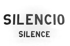 Silence signboard. Horizontal photo in black and white of a signboard of silence area royalty free stock photography
