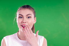Silence or speak from beautiful woman on green Stock Image