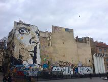 Silence ! Street art in Paris. Face of a man Stock Image