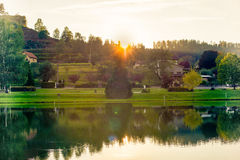 Silence of sunset over the lake. Great sunset in autumnal french evening over the silent lake Stock Photography