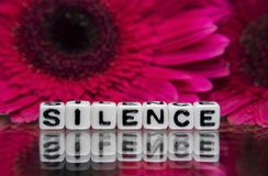 Silence text message with flowers Stock Photos