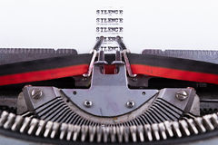 Silence written on an old typewriter . Stock Photography