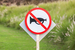 Silence zone in rural scene, the warning sign do not use vehicle. Silence zone in rural scene, the white and red circle warning sign of do not use vehicle horn royalty free stock photo