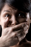 Silenced. Young woman is being silenced Stock Images