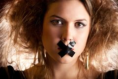 Silenced woman Royalty Free Stock Photography