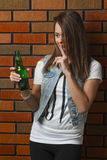Silencing a beer Stock Photo