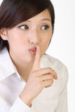 Silent. Closeup portrait of business woman with silent sign gesture on lips Stock Photography