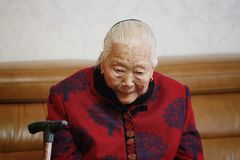 Silent Asian Chinese 90s old woman thinking. Sad and lonely Asian Chinese old woman, 93 years old, up to 90s , silvery hair, golden earing on her ear Royalty Free Stock Photos