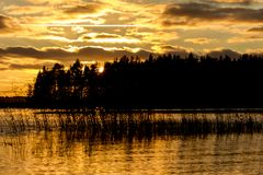 Silent calm lake at sunset. Republic of Karelia, Russia royalty free stock images