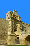 The medieval citadel of Mdina. Narrow stone bridge over a moat and a Baroque main gate constructed in 1724, entrance to  the Silent City, government and Royalty Free Stock Photo