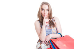 Silent concept with stylish beautiful woman doing shush gesture Stock Photo