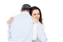 Silent couple comforting each other. Against white background Royalty Free Stock Photography