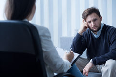 Silent depressed man. Silent depressed middle aged men on psychotherapy Royalty Free Stock Images