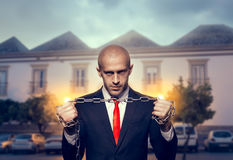 Silent killer with iron chain in hands Stock Photography