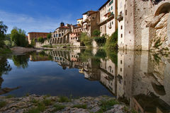 Silent lake in ancient city. The medieval city constructed on rocks about the mountain river stock image
