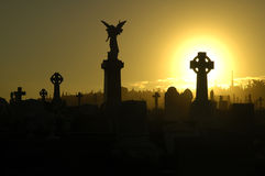 Silent night. Silent evening scene at an old cemetery, silhouettes of graves, crosses and statues, black and yellow dominant colors Stock Photography