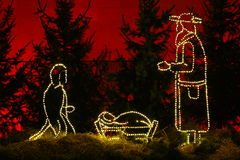 Silent night illuminated manger stock photography