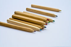 Silent pencils. Pencils spread out over the table Royalty Free Stock Photo