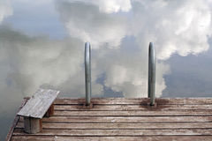 Silent Place. A empty pier on lake and sky Royalty Free Stock Image