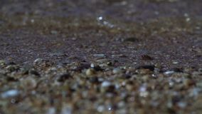 Silent sea wave overturns sand ashore slow motion stock video