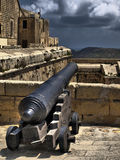 Silent Sentinel. Medieval cannon on the bastions of the Citadel in Gozo Stock Photos