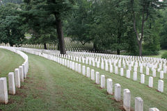 Silent Sentinels. Rows of military graves on beautiful rolling hills Stock Photography