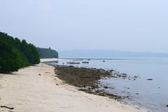 Silent and Serene White Sandy Beach with Rocks and Greenery and Boats at Distance - Kalapathar, Havelock, Andaman, India. This is a photograph of white sandy royalty free stock photos