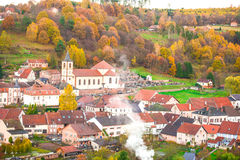 Silent and smoked french mountain village in autumn. Top viex of alsacian village and forest in early autumn Royalty Free Stock Photos