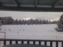 Snowy field facing Smith Rock, Oregon stock photo