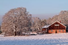 Silent farm in wintertime in Finland Royalty Free Stock Photo
