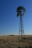 Silent Windmill. Windmill used for pumping water underground is still in a farm paddock in northern Victoria, Australia. Late in the afternoon, the windmill is Royalty Free Stock Photo