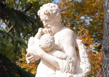 Silenus carrying Dionysus in the arms Stock Image