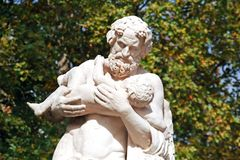 Silenus with Dionysus, old antique statue. Royalty Free Stock Photos