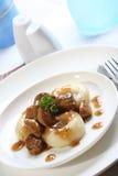 Silesian dumplings on white plate Stock Photos