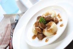 Silesian dumplings on white plate Stock Image