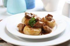 Silesian dumplings on white plate Stock Photography
