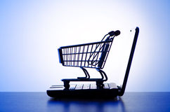 Silhoette of laptop and  cart Royalty Free Stock Image
