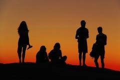 Silhouet bij zonsondergang Stock Foto