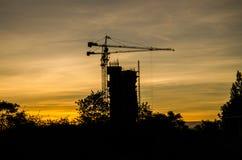 Silhouet, contruction, kraan, bij, zonsopgang Stock Afbeeldingen